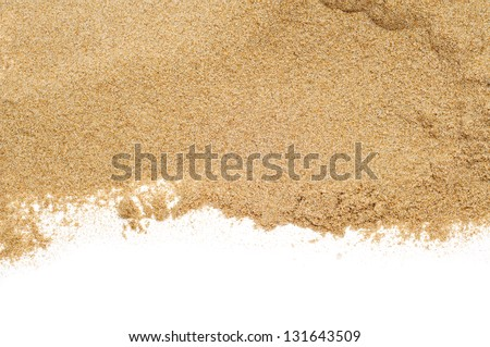 closeup of a pile of sand of a beach or a desert on a white background - stock photo
