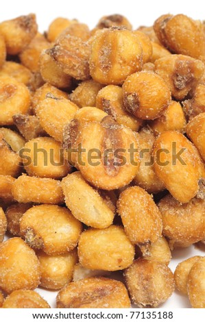closeup of a pile of toasted salted corn on a white background - stock photo