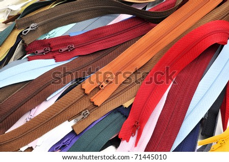 closeup of a pile of zippers of many colors
