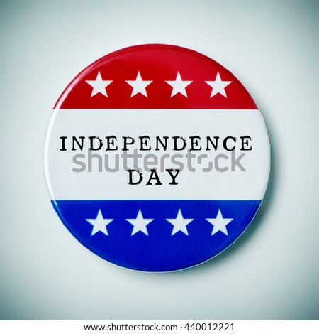 closeup of a pin button with the text independence day and the colors and stars of the flag of the United States, with a slight vignette added