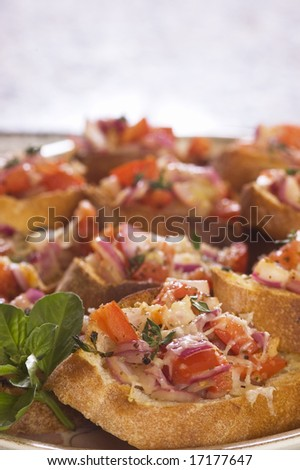 closeup of a plate of Bruschetta - stock photo