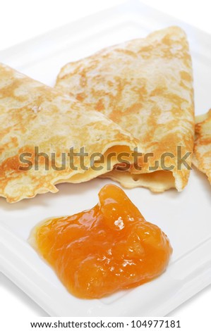 closeup of a plate with crepes and jam - stock photo