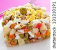 closeup of a plate with ensaladilla rusa, russian salad, typical tapas in Spain - stock photo