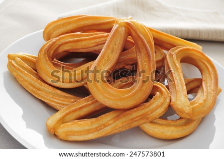 closeup of a plate with some churros typical of Spain - stock photo