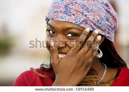 Closeup of a pretty African American woman with a scarf