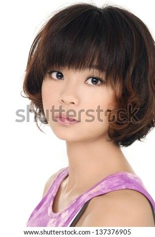 Closeup of a pretty young asian woman isolated on white background - stock photo
