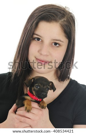 Closeup of a pretty young teen happily holding her tiny, new mixed-breed puppy.  On a white background. - stock photo