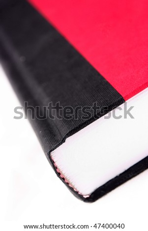 Closeup of a red and black book isolated on a white background - stock photo