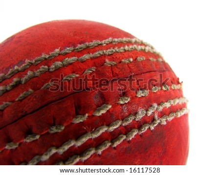 Closeup of a red cricket ball showing the seam - stock photo