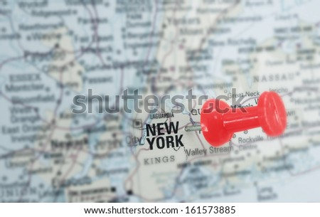 Closeup of a red push pin in a map of New York City                                - stock photo