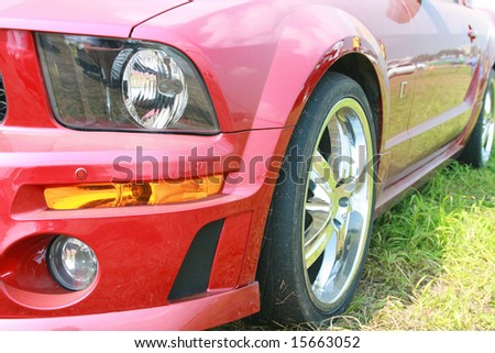 Closeup of a  red sports car - stock photo