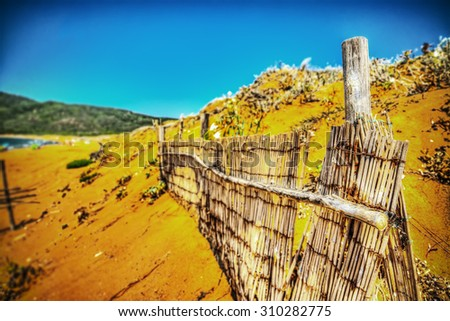 closeup of a reed fence by the sea in Porto Ferro, Italy - stock photo