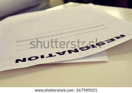 closeup of a resignation letter on a white office desk