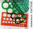 Closeup of a retro colorful templates for the manual drawing circles, ovals, curves etc.Situated on an architectural drawing. Good as abstract background. - stock photo