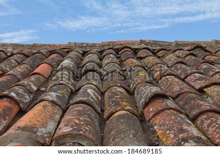 Closeup of a roof tile against blue sky - stock photo