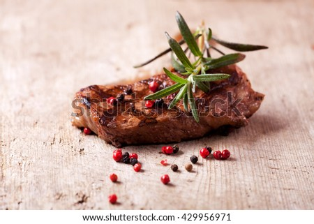 closeup of a rosemary leaf on a steak