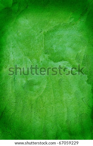 Closeup of a rough wall in green. - stock photo