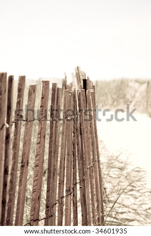 Closeup of a row of fencing at the beach.  Shallow depth of field. - stock photo