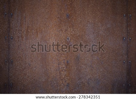 Closeup of a rusty metal surface, suitable for background. Lens vignetting applied. - stock photo