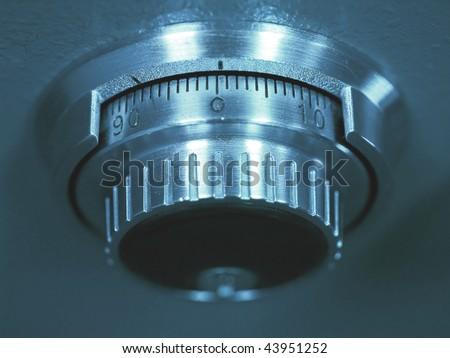 Closeup of a Safe Vault Combination Spinner - Blue Toned - stock photo