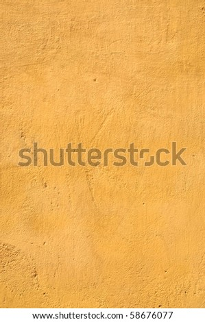 closeup of a sand colored wall. - stock photo