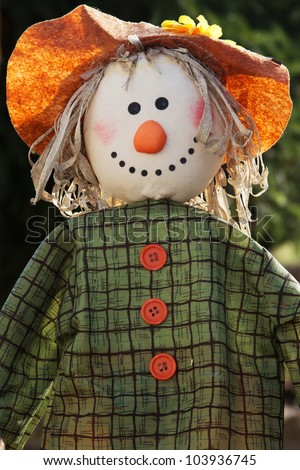 Closeup of a scarecrow with sunlight in the garden - stock photo