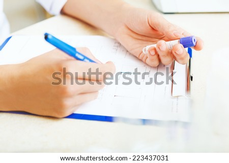 Closeup of a scientist working with samples in lab. - stock photo