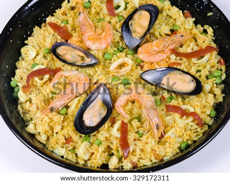 Closeup of a seafood paella - stock photo