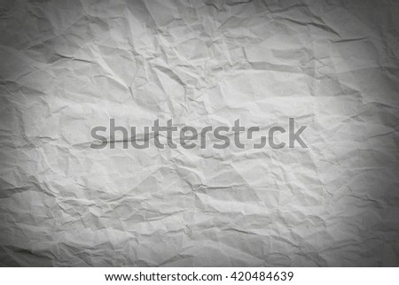 Closeup of a section of crumpled wrapping paper with vignette effect
