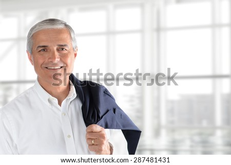 Closeup of a senior businessman holding his jacket over his shoulder in an office interior. Horizontal format with copy space. - stock photo