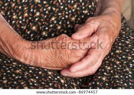 Closeup of a senior woman's hands together - stock photo