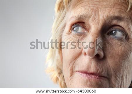 Closeup of a senior woman's visage - stock photo