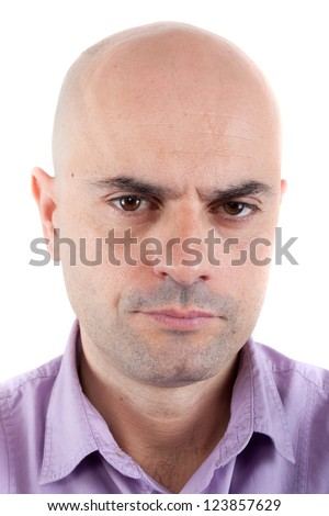 Closeup of a serious and angry bald man looking at camera. Lilac shirt. Isolated.