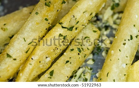 Closeup of a Serving of Seasoned French Fries - stock photo