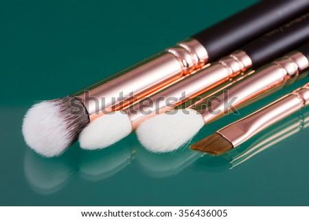 Closeup of a set of makeup brushes - stock photo