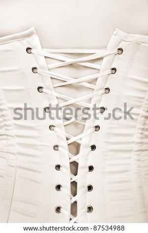 Closeup of a sexy corset, monochrome photo - stock photo