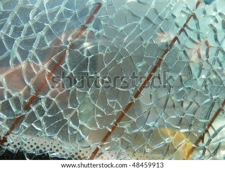 closeup of a shattered safety pane of a car - stock photo
