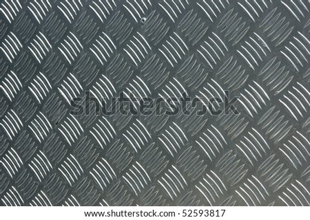 Closeup of a sheet of aluminium checker plate. - stock photo