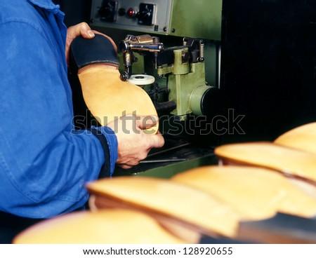 Closeup of a shoemaker making shoe - stock photo