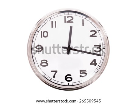 Closeup of a simple clock isolated on white background - stock photo