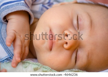 Closeup of a sleeping baby in horizontal format.