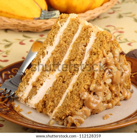 Closeup of a slice of pumpkin cake on a plate - stock photo
