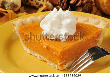 Closeup of a slice of sweet potato pie with shipped cream - stock photo