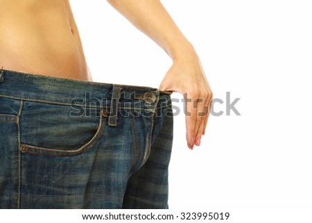 Closeup of a slim female body, isolated on white - stock photo