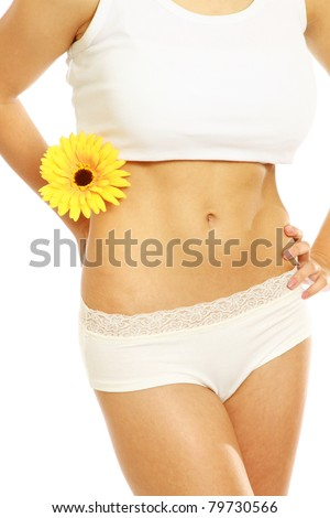 Closeup of a slim female body with a flower, isolated on white