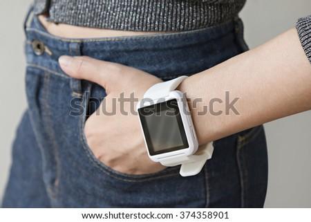 Closeup of a smart watch  on a Woman's wrist. - stock photo