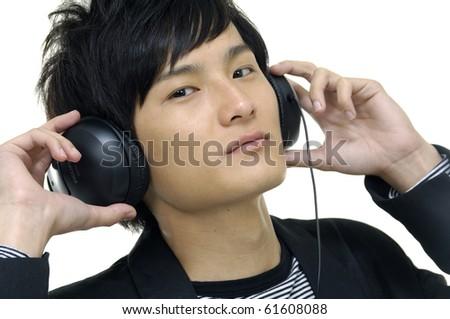 Closeup of a smart young guy enjoying music - stock photo