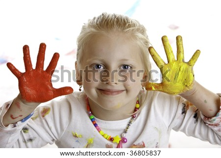 Closeup of a smiling child with painted hands - stock photo