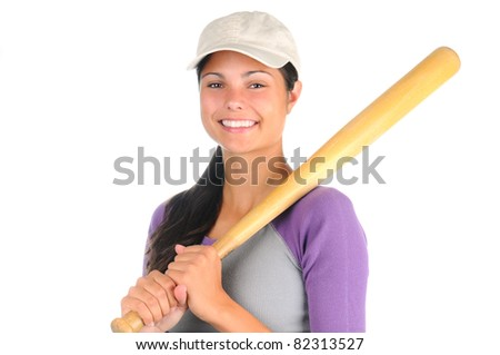 Closeup of a smiling female softball player holding a wooden bat on her shoulder. Horizontal format isolated on white.