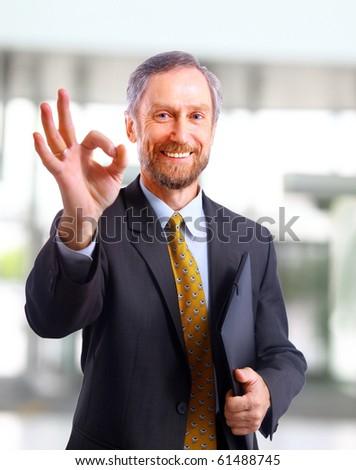 Closeup of a smiling senior businessman - stock photo